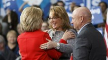 As Iowa caucuses loom, Clinton and Giffords team up on gun control