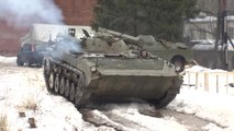 Russian Daredevil Snowboarders Pulled by Infantry Fighting Vehicle