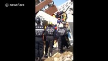 Man rescued alive from Taiwan earthquake after 30 hours trapped