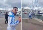 Un supporter marseillais pousse un parisien dans le vieux port