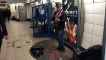 Amazing busker covers Sultans of Swing at Bank Station, London