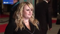 Rebel Wilson is suited and booted on BAFTAs red carpet