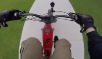 A man films his ride at 80km/h in the streets of Sydney on board his electric bike Bomber B-52.