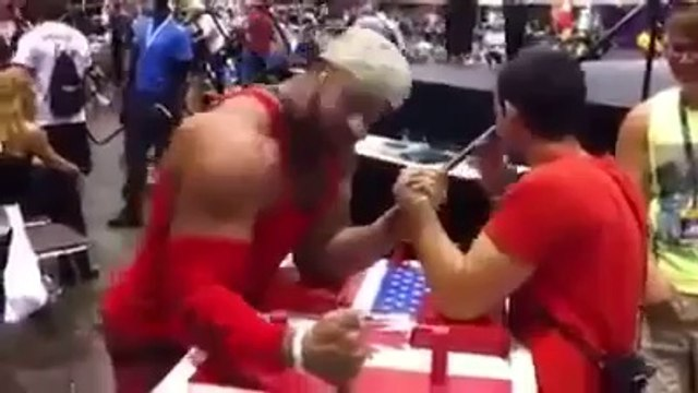 Tiny Arm Wrestler wins while taking selfie picture!