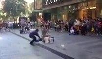 Dumb Guy annoys Street Drummer