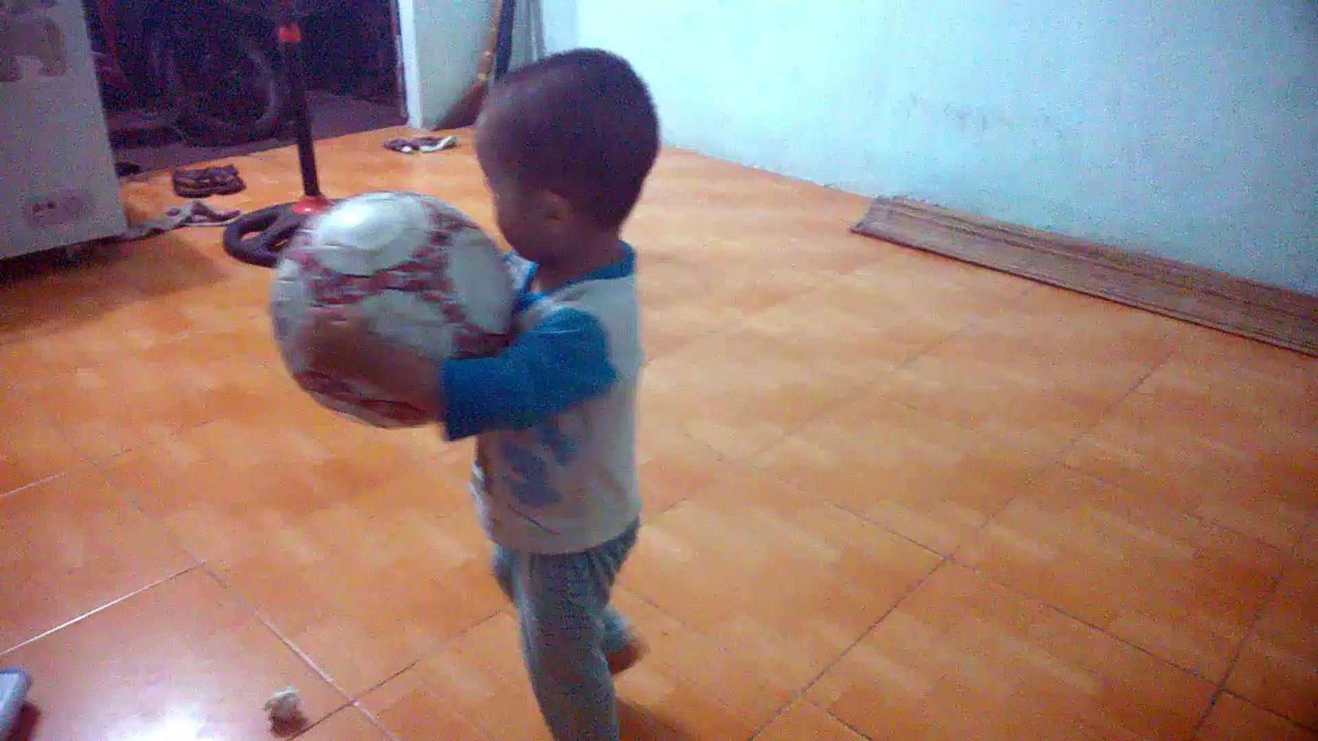Cute Kid playing football - kids studio