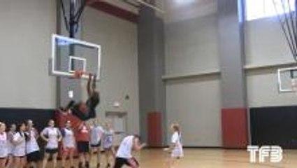 High School Basketball Coach Dunks Over Player