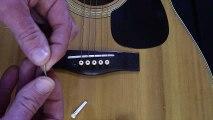 Comment changer les cordes des guitares folk et électriques