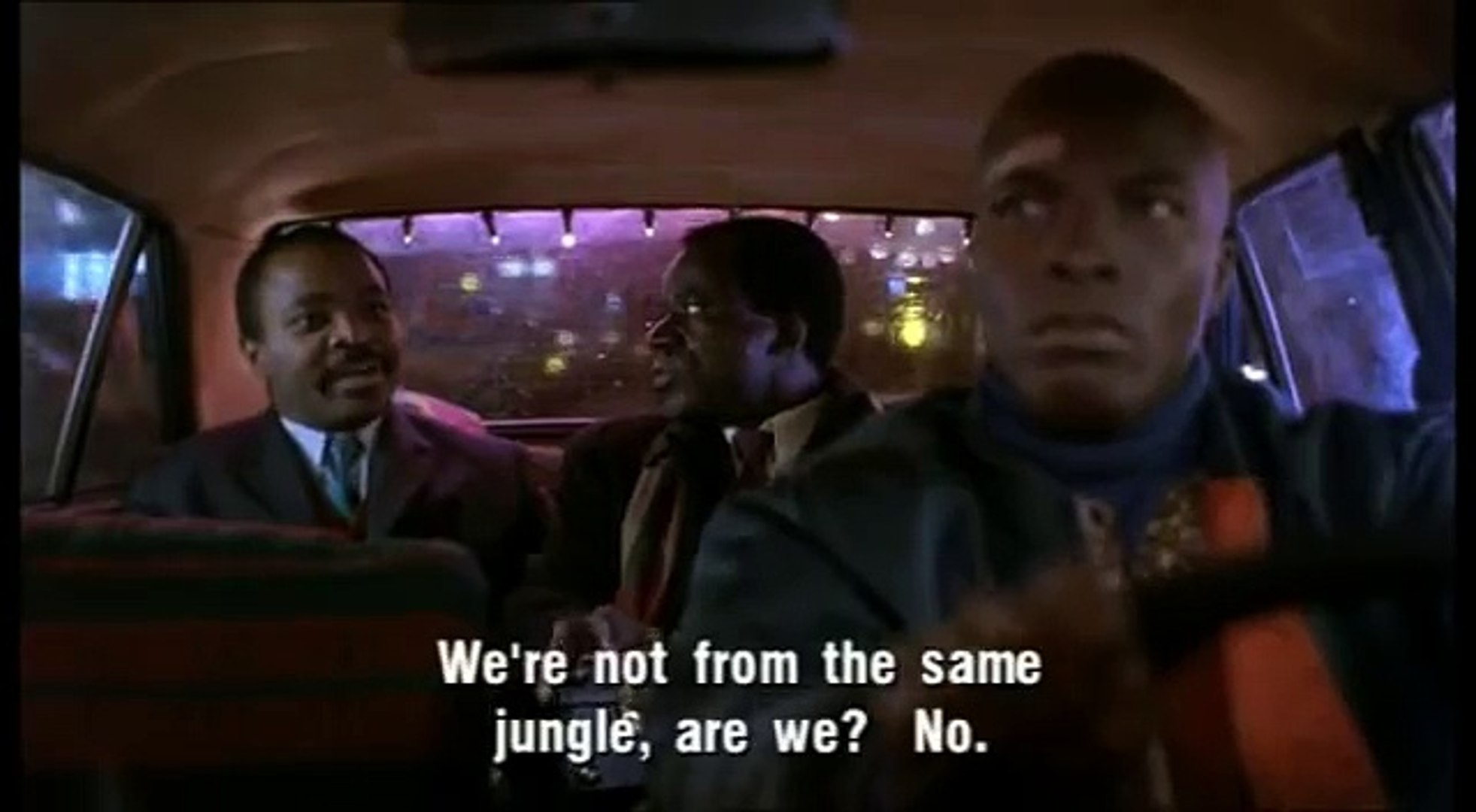 Two African diplomats mock an African cabby