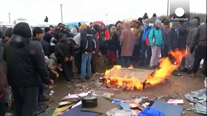 Distressing scenes as Calais migrant camp eviction resumes after clashes