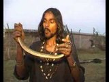 A Man Eating Snakes Alive