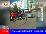 Powerless Chinese traffic cop - collapsed after being slapped three times in the face