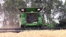 John Deere S680 Combine on Tracks Harvesting Wheat