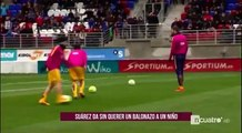 Luis Suarez and a noble gesture kid who hit a ball warming