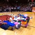 Une mascotte de NBA tente un salto au dessus d'autres mascottes et fail