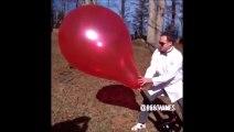 Explosion d un gros ballon filmພ au ralenti - Slow motion