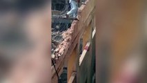 Terrifying moment Daredevil construction worker destroys wall he is standing on