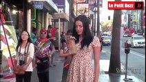 Elle fait semblant d'être bourrée pour voir la réaction des gens dans la rue !