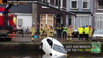 Mom, child rescued from sinking car: four passersby heroically pull pair from canal - TomoNews