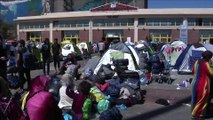 Greece begins moving hundreds of refugees stranded at port to other towns