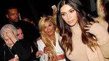 Paparazzi Falls into Kim Kardashian during Frenzy with Lil Kim