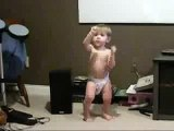 Baby dancing to rave music techno