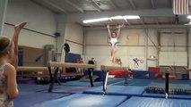 Elena's back walk over back handspring on high beam