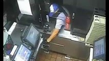 A clumsy thief tries to steal the cash register of a fast-food