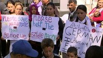 Refugees on the Greek island of Lesbos welcome Pope Francis