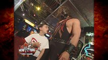 Kane Helps a Kid Win a Prize at WWF New York 6/18/01