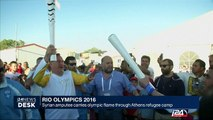 Rio Olympics: Syrian amputee carries olympic flame through Athens refugee camp