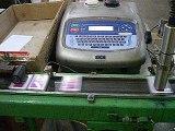 Máy in phun date code tự động trên bao bì thuốc lá - VMSCO.VN