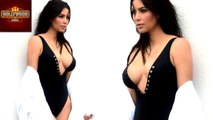 Kim Kardashian Shows Off Ample Cleavage In Skimpy Swimsuit | Hollywood Asia
