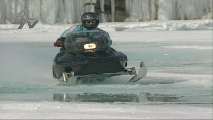 When the fishin' is slow . . . . take a snowmobile out on the lake!