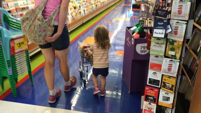 Shopping with her toy cart at Giant 8/23/15