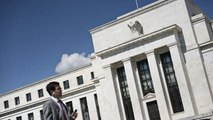 Fed leaves door open for June rate hike, and other MoneyWatch headlines