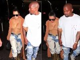 Kim Kardashian holds onto Kanye West's arm Kim Kardashian and Kanye West