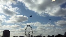 V-22 Ospreys military aircraft low flying over London Eye, Thames, Shard patrolling helicopters