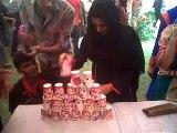 Cups Re-Arranging in A minute by A girl 2 - SKANS Funfair 2011, Multan