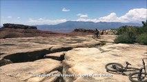 Ce cycliste tente un saut au bord d'une falaise et se rate... Chaud