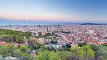 View of Barcelona day to night timelapse, the Mediterranean sea, The tower Agbar and The twin towers