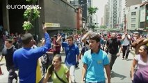 Venezuelans protest as the country suffers hyperinflation, power cuts, and food shortages