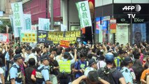 Hong Kong bookseller defies Beijing by leading protest