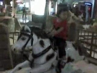 Nicole playing kiddie ride #17