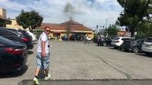 Un homme courageux sauve une victime coincée dans sa voiture en feu