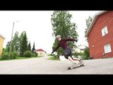 Downhill Freestyle Skateboarder Shows Off His Moves