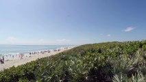 Lancement d'une fusée Atlas V par la Nasa filmé d'une plage