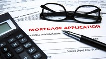 Mortgage rates drop toward new lows, and other MoneyWatch headlines