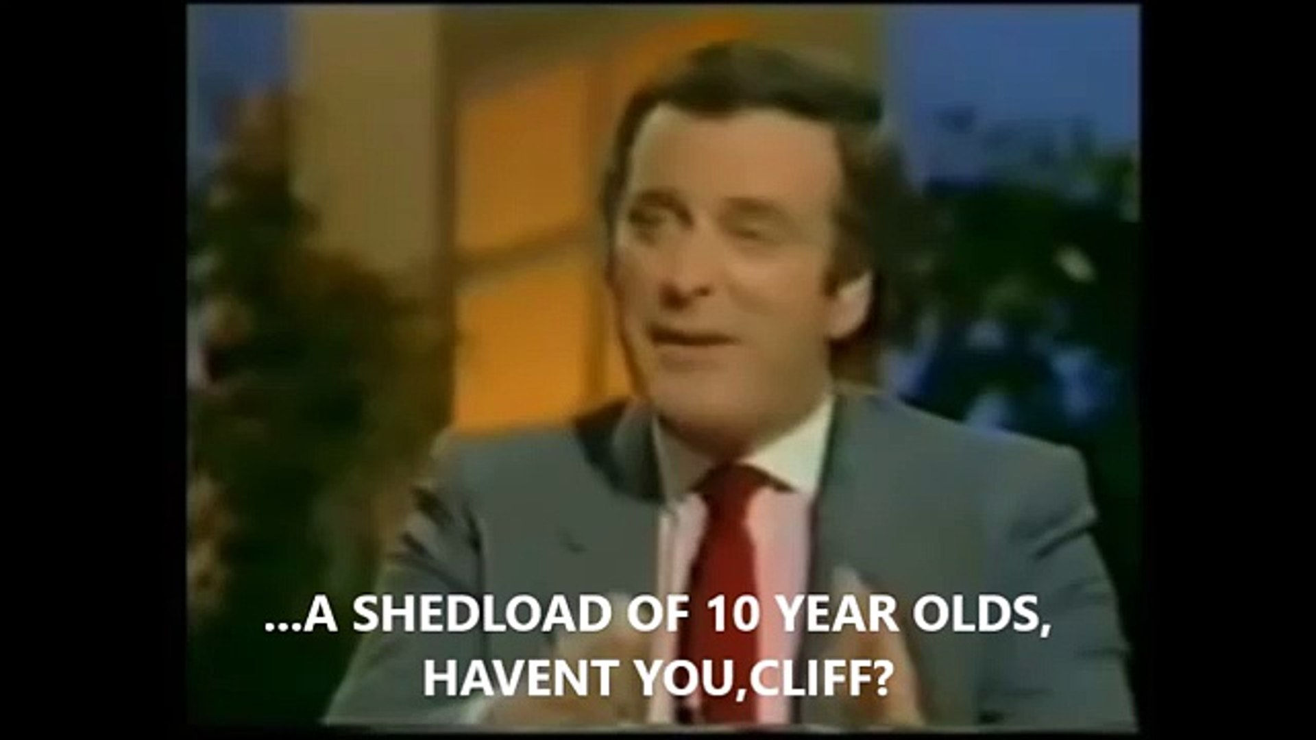 TERRY WOGAN GRILLS CLIFF RICHARD ABOUT 10 YEAR OLDS.1984