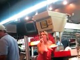 Drunk girl argues with a group of guys, throws fries at them